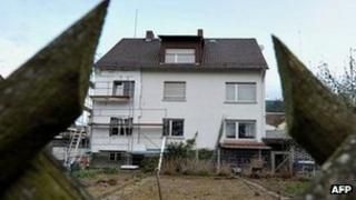 The dead bodies of three babies were found in a cellar and a garage belonging to their mother's flat in this house near the German city of Giessen (April 2012)