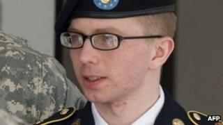 Pte Bradley Manning leaves the courtroom in Fort Meade, Maryland 25 April 2012