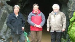 Cornwall councillors - Richard Pugh, Bernie Ellis and Brian Gisbourne - outside the cave
