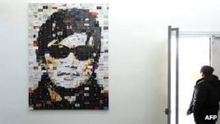 An art work featuring blind human rights activist Chen Guangcheng on displayed at the 798 art district in Beijing, 09 Jan 2012