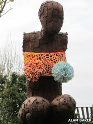 Yarn-bombed statue