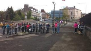 The crowd begins to gather at Armagh Jail to await the arrival of the Royal couple