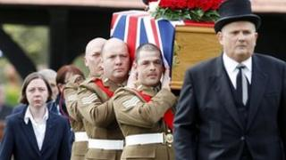 The coffin of Sgt Nigel Coupe is brought to St Annes Parish Church