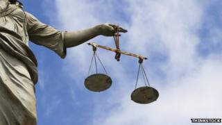 Statue holding scales of justice