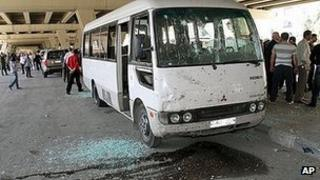 A damaged bus at the scene of the explosion in Midan, Damascus