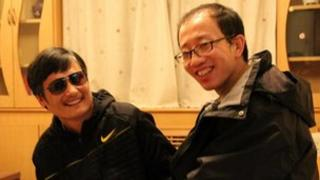 Chen Guangcheng and Hu Jia appear together in photo released by Mr Hu's wife Zeng Jinyan on social network site Twitter