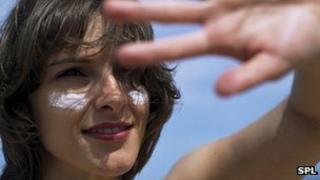 Woman with sun cream