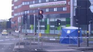 Blue police tent at scene