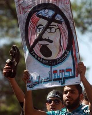 Egyptian protesters take part in a demonstration in front of Saudi Arabian embassy in Cairo on April 24, 2012, calling for the release of Ahmed al-Gizawi who arrested on April 17