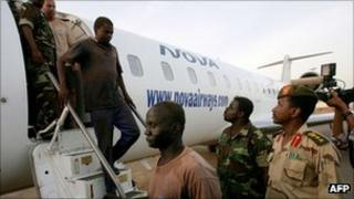 Men captured by Sudanese forces arrive in Khartoum