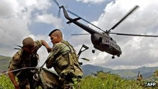 Colombian soldiers dropped by helicopter in operation against Farc rebels, file picture