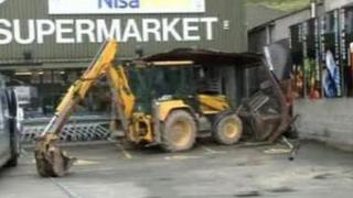The digger outside CK's Supermarkets in Newcastle Emlyn