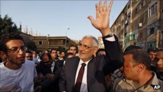 Abdul Moneim Aboul Fotouh waves during campaigning in Monofeya, 70km north of Cairo
