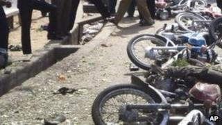 A row of toppled bikes after a bomb hit Jalingo, Nigeria, Monday, April 30, 2012