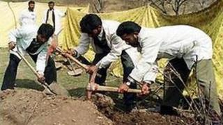 Police later exhumed the bodies of the killed men