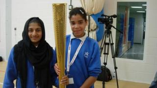 School Reporters hold Olympic Torch