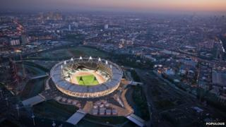 The London 2012 Olympic Stadium in Stratford with CGI of the fabric wrap that will go round it
