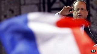 A French flag flutters as Francois Hollande makes an election visit to Nice, southern France, 28 March