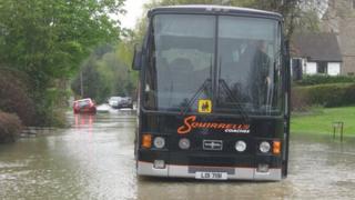 School bus in flood water in Hessett, Suffolk