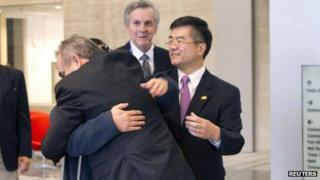 A handout photo from US Embassy shows Chen Guangcheng hugging US Assistant Secretary of State for East Asian and Pacific Affairs Kurt Campbell (front) as US Ambassador to China Gary Locke (R) looks on, in Beijing, 2 May 2012