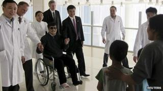Blind activist Chen Guangcheng (in wheelchair) meets wife and children in Beijing hospital after leaving US embassy