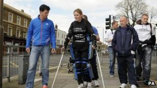 Tim Henman walking with Claire Lomas