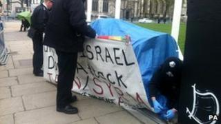 Police removing the last anti-war tent