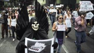 Protesters march against the killing of Mexican journalists Regina Martinez in Xalapa, Veracruz state, 29 April.