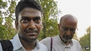 Indian district official Alex Paul Menon, left, walks with mediator B.D.Sharma after his release by Maoist rebels at Tadmetla, in Chhattisgarh state, India, Thursday, May 3, 2012.
