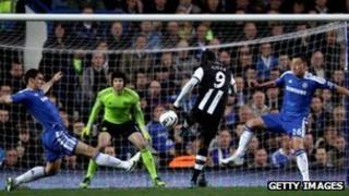 Papiss Cisse of Newcastle scores against Chelsea
