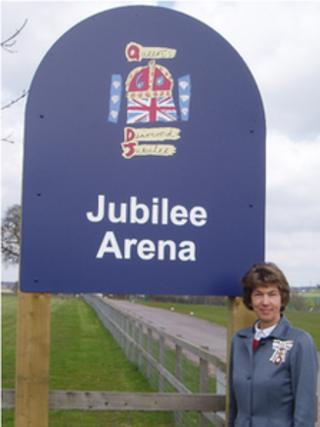 Lady Verulam with the Queen's Diamond Jubilee Arena sign