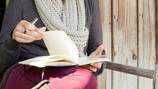 Woman writing diary