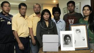 Aceh community members in Paraguay with a box containing the returned skull of Damiana Kryygi