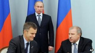"""Russian Prime Minister and President-elect Vladimir Putin, Norway""""s Statoil Chief Executive Helge Lund, left, and Rosneft president Eduard Khudainatov"""