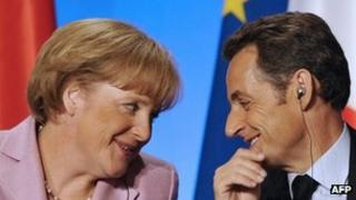 French President Nicolas Sarkozy looks at German chancellor Angela Merkel as he participates in a press conference in 2008
