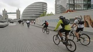Cyclists with Tower Bridge in background