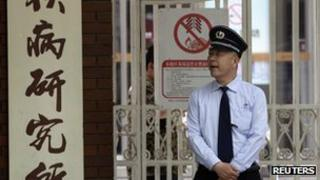 A security guard outside the hospital where activist Chen Guangcheng is being treated