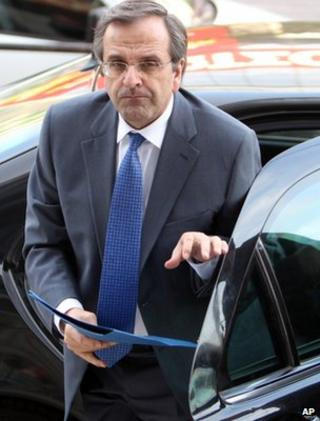 Antonis Samaras arrives at the headquarters of his party in Athens, Monday, May 7
