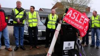 """Members of the drivers"""" union Aslef protest during a strike outside Derby Train Station in a dispute over pensions. Tuesday May 1, 2012"""