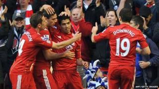 Liverpool's Luis Suarez celebrates with his teammates