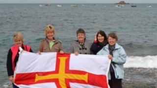 The Guernsey flag at Cobo Bay