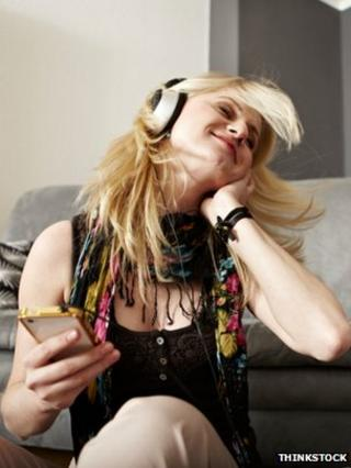 Woman listening to music via a smartphone