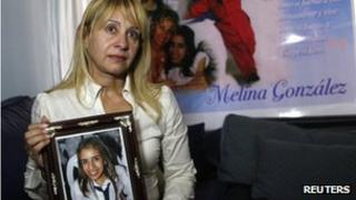 Susana Bustamante with a photograph of her daughter Melina