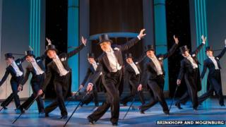 Tom Chambers (Jerry Travers) and the Male Ensemble of Top Hat. Photo Credit Brinkhoff and Mogenburg