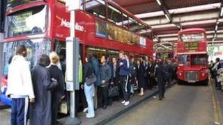 People getting on a bus