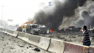 A man runs to offer help at the site of an explosion in Damascus 10 May, 2012