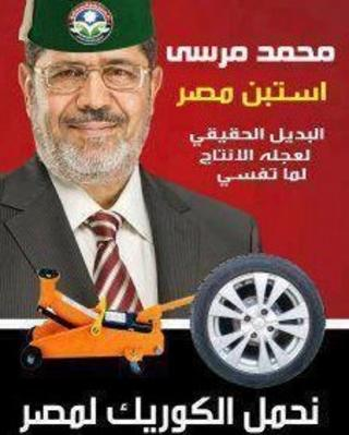 Mohammad Mursi with car jack