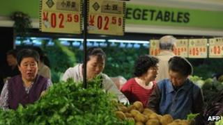 Consumers buying vegetables in China
