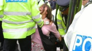 Police officer arresting Lorraine