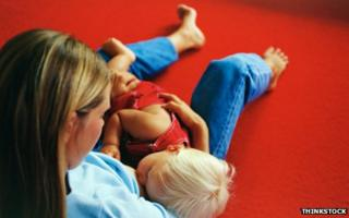 Mother breastfeeding her son